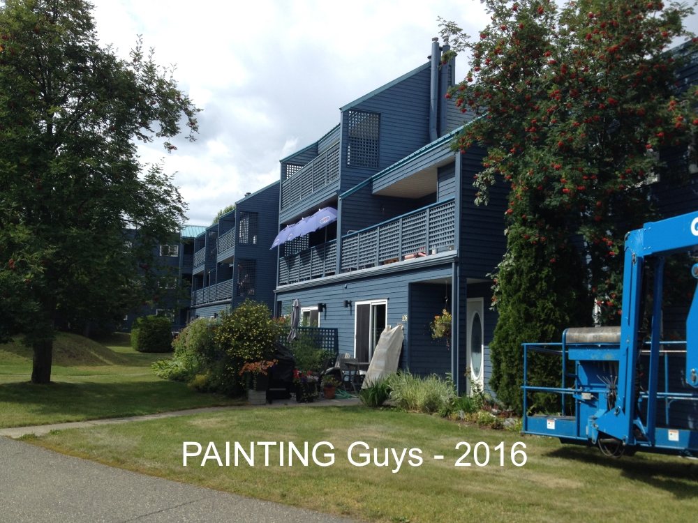 Commercial painters staining Centaur Prince George