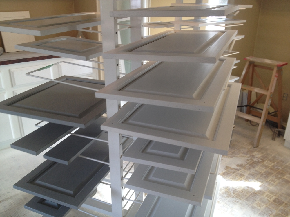 painted oak cabinets in drying rack