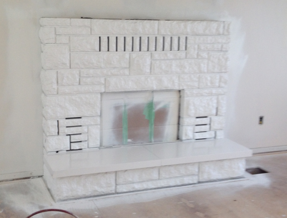 painting concrete fireplace - after