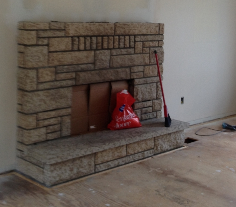 painting concrete fireplace - before
